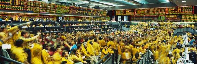 OTC - Frenzied pit traders on a centralized exchange floor.